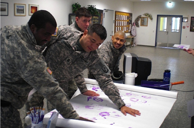 U.S. Army servicemen taking the pledge in October for Domestic Violence Awareness month